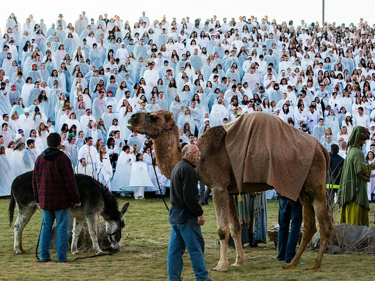 In this photo taken on Monday, Dec. 1, 2014, more than 1,000 participants gather at Rock Canyon Park in Provo, Utah, in an attempt to set a world record for the largest recreation of a live Nativity scene. (AP Photo/The Deseret News, Scott G Winterton)  SALT LAKE TRIBUNE OUT;  MAGS OUT