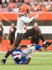 Aug 17, 2018; Cleveland, Ohio: Cleveland Browns quarterback Tyrod Taylor (5) avoids the sack by Buffalo Bills defensive tackle Star Lotulelei (98) during the first half at FirstEnergy Stadium.