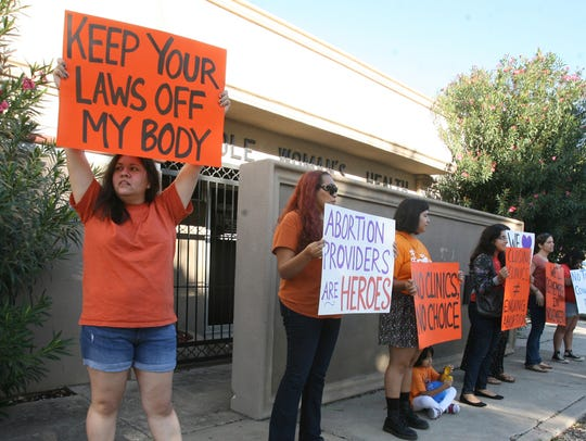 Women protest in front of Whole Woman's Health clinic