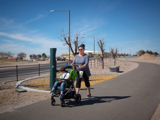 Nancy Hawkins pushes 2 1/2-year-old Brody Hakwins on a walking track at Pat and Lou Sisbarro Community Park. Nancy Hawkins usually walks in the park four times a week for 40 minutes.