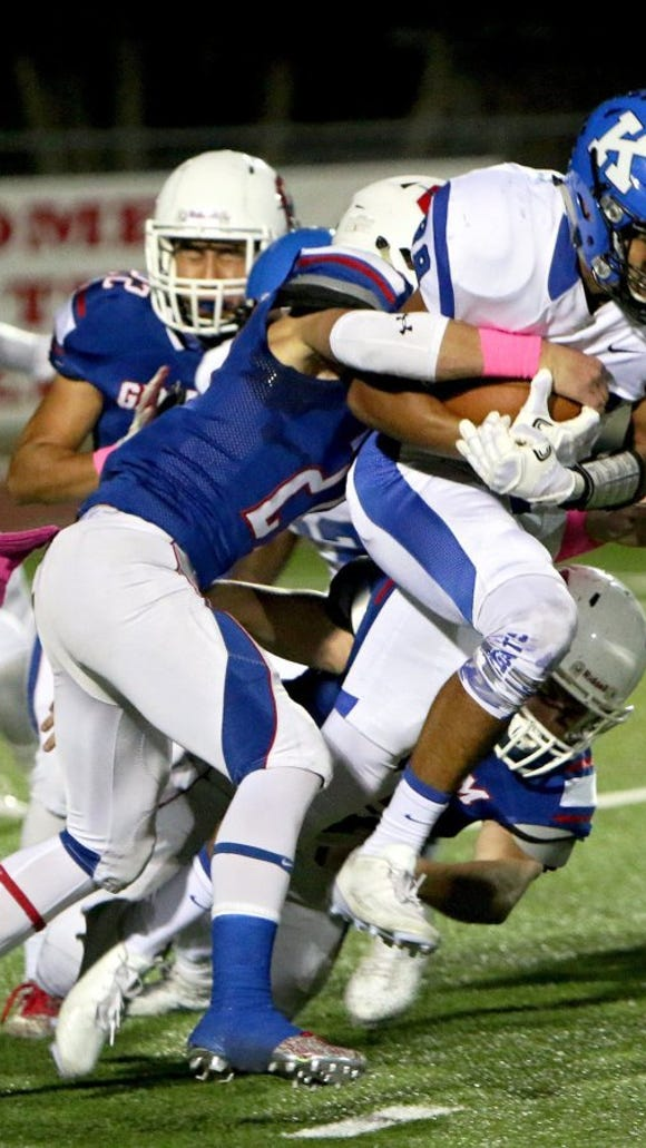 Patrick Johnston/Times Record News Krum's Justus Martinez holds on to the football while fighting for extra yardage as several Graham defenders bring him down Friday night in Graham.