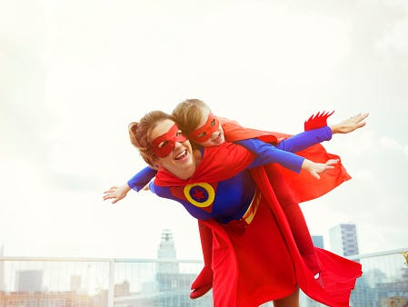 Snap a photo of your mom, give her a superhero title and tell us why. She could win a $500 Visa gift card!