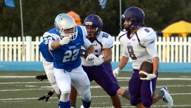 Clovis' Seth Lopez tries to evade Carlsbad's Isaiah Perez in the first quarter Friday.