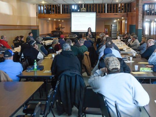 Farmers listen to a presentation by University of Minnesota