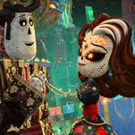 """This image released by Twentieth Century Fox shows the characters Manolo, voiced by Diego Luna, left, and Carmen Sanchez, voiced by Ana de la Reguera in a scene from """"The Book of Life."""""""