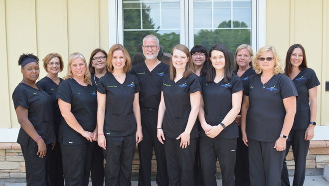 Dr. John Koziarski and the staff of Family Surgical in Battle Creek. Next month, Family Surgical will become Restorative Health Care and move to a new office within the city.