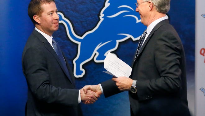 New Detroit Lions general manager Bob Quinn, left, is greeted by team president Rod Wood after being introduced during a news conference on Jan. 11 in Allen Park.