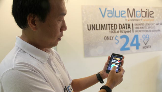 iConnect financial controller Rene Lau demonstrated the new advertising supported phone service from Value Mobile at an unveiling event Wednesday, February 1, 2017.