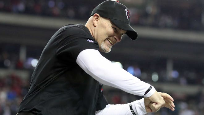 Atlanta Falcons head coach Dan Quinn celebrates after defeating the Green Bay Packers in the 2017 NFC Championship Game at the Georgia Dome.