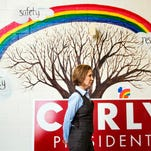 Carly Fiorina stands in front of a mural in the hallway while waiting to be introduced at a campaign event at Maple Avenue Elementary School on Feb. 6, 2016, in Goffstown, N.H.
