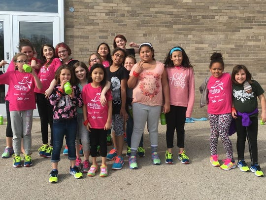 A Girls on the Run Team from Riverside Elementary School gets ready to train. The program teaches girls to be strong, both mentally and physically, by completing a 5K run.
