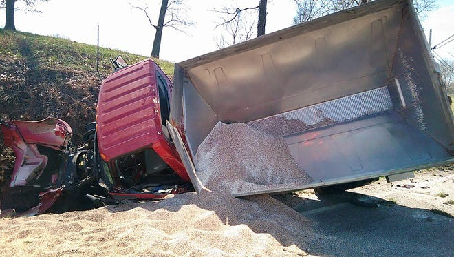 These are the 11,000 pounds of fertilizer that spilled from the 2006 red farm truck after it crashed on Dobbins Pike in Portland on Tuesday, March 29, 2016.