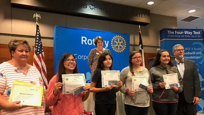 Driscoll Middle School math techer Andrea Lobaugh (far left) and students Chula Salinas, Ariel Mejia, Alexis Orozco, and Cassandra Araiza were honored by the Rotary Club of Corpus Christi during the group's monthly club meeting. Not pictured are students Dejon Bisby and Josh Leon.