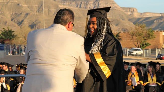 Alamogordo Public Schools Board member David Borunda had a 2018 graduate her diploma Friday evening.