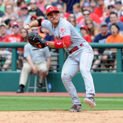 Cincinnati Reds first baseman Joey Votto (19) makes a throwing error on a hit by Cleveland Indians center fielder Michael Brantley (not pictured) during the sixth inning at Progressive Field.