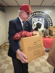 The Palmyra VFW Memorial Post 6417 teamed with the Central Pennsylvania Food Bank's MilitaryShare Program to provide free food distribution for active service members, veterans and their families in need. Following pre-registration food is distributed once a month at locations, including the Palmyra post, throughout the Central Pennsylvania's Food Bank's 27-county service area. Pennsylvania State Rep. Frank Ryan helps to carry a box of donated food to the car for a fellow veteran.