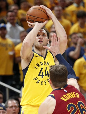 Indiana Pacers forward Bojan Bogdanovic (44) shoots a three-pointer over Cleveland Cavaliers guard Kyle Korver (26) during the second half of Game 6 at Bankers Life Fieldhouse on Friday, April 27, 2018.