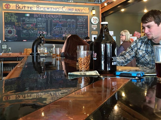 A copper strip in the concrete bar of the Butte Brewing Co. is designed to keep beer cold.