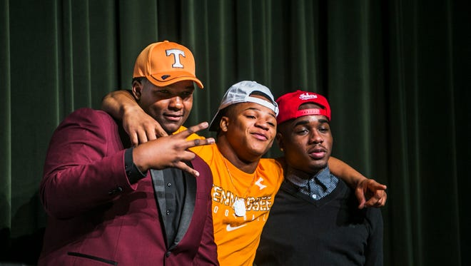 From left, Cordova football players Jerome Carvin (offensive lineman), Jeremy Banks (running back), and Jacolby Hewitt (wide receiver) pose for photos on the first day of the early signing day period Dec. 20. Carvin and Banks signed with Tennessee; Hewitt committed to Indiana.