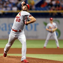 Michael Wacha #52 of the St. Louis Cardinals pitches during the first inning of a game against the Tampa Bay Rays.