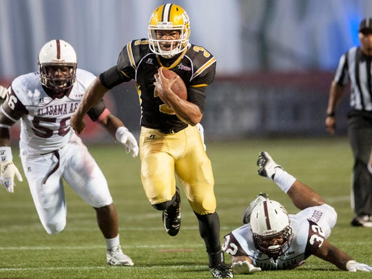 Alabama State quarterback Ellis Richardson (3) carries
