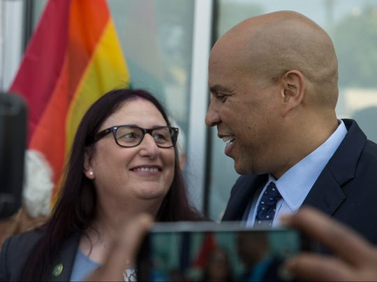 Jennifer Long, former soldier, shares a moment with Booker. Sen. Cory Booker (D-NJ) visits Garden State Equality headquarters in Asbury Park to rally with supporters against President Trumps military transgender ban. 