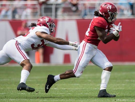 Alabama running back Brian Robinson Jr. (24) eludes