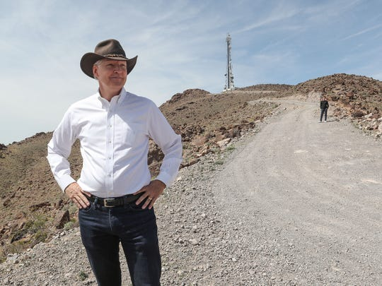 Tom Gammon looks at a Mojave National Preserve, near a cell tower built by his company, Interconnect Towers, in a desolate area along Interstate 40 in the California desert.