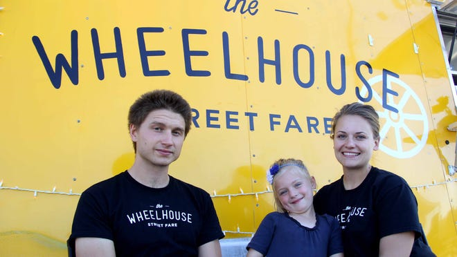 Steven Smallwood, left, is one of the co-owners of Wheelhouse. His brother's wife, Melissa Smallwood (right, with her daughter Mabel), works at the food truck.