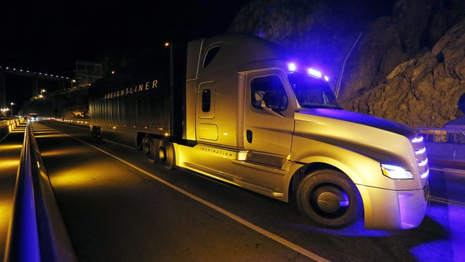Daimler Trucks North America shows off a self-driving big rig atop the Hoover Dam in this file photo.