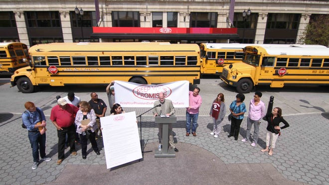 The Keep Your Promises group spoke Thursday morning at Rodney Square across from DuPont's former headquarters.