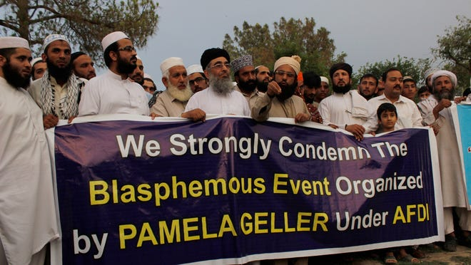 People in northwest Pakistan condemn an organizer for a May 5, 2015, event in Texas. Two men were killed in the U.S. state after they opened fire at a cartoon contest featuring images of the Muslim Prophet Muhammad.