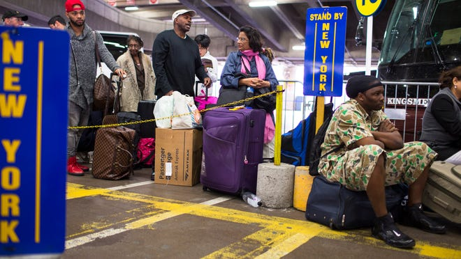 Passengers in the standby area wait for a seat on their way to New York on Wednesday, May 13, 2015, in Washington. Thousands of commuters and travelers had to scramble Wednesday after a deadly Amtrak train derailment shut down a critical section of the busiest railroad in North America. (AP Photo/Brett Carlsen)