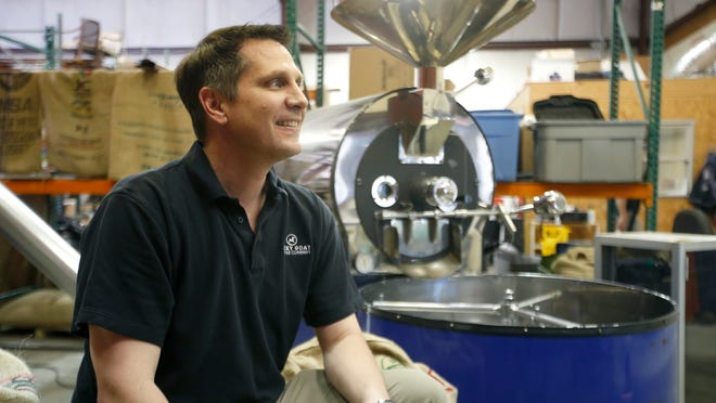 Lucky Goat Coffee owner Ben Pautsch sits in the company's wholesale warehouse space.