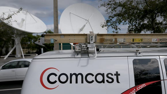 A Comcast truck is seen parked at one of their centers