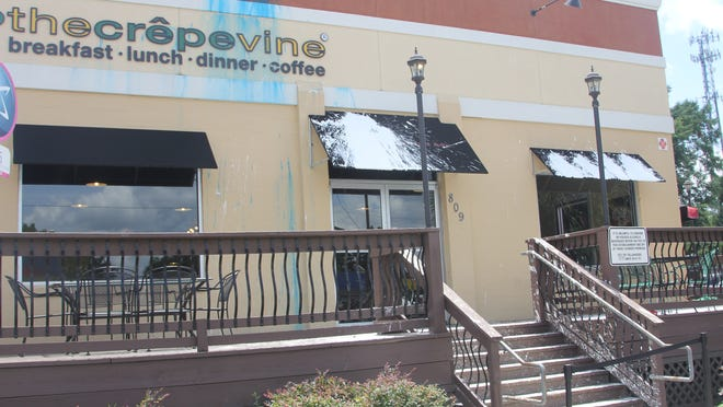 The Crepevine restaurant splattered with white paint on Thursday.