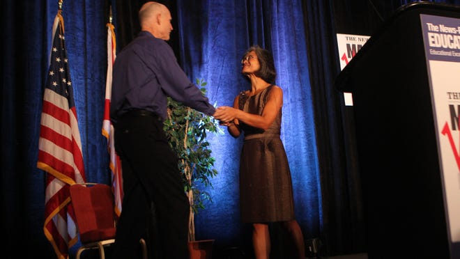 Mei-Mei Chan welcomes Florida Gov. Rick Scott to the first The News-Press Market Watch Education Summit at the Hyatt Regency Coconut Point in Estero in 2011.