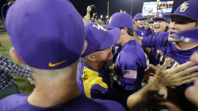 LSU baseball coach Paul Mainieri celebrates with his team after the Tigers defeated UL Lafayette on June 7 to advance to the College World Series.
