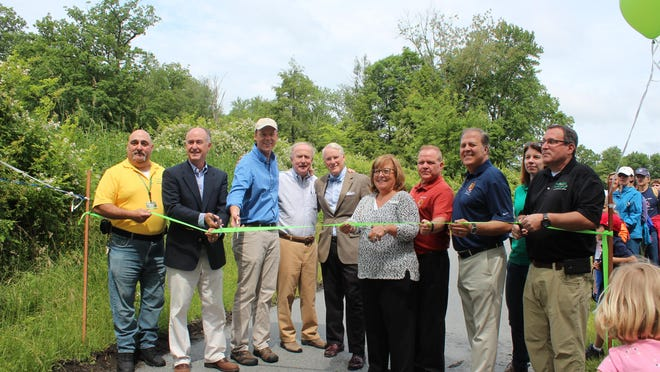 From left: Russ Nee, Morris County Park Commission trail foreman; Kevin Sullivan, mayor of Chatham Township; Terrence Nolan, senior vice president of conservation transactions, Open Space Institute; Rep. Rodney Frelinghuysen; Nicolas Platt, mayor of Harding Township; Kathryn A. DeFillippo, freeholder director; Douglas Cabana, freeholder; Thomas J. Mastrangelo, freeholder; Sue Seyboldt, NJ Green Acres; and David Helmer, executive director, Morris County Parks Commission.