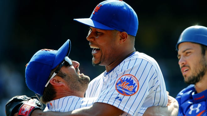 Jun 14, 2015; New York City, NY, USA; New York Mets hitting coach Kevin Long (57) and relief pitcher Jeurys Familia (27) celebrate after defeating the Atlanta Braves 10-8 at Citi Field. Mandatory Credit: Noah K. Murray-USA TODAY Sports