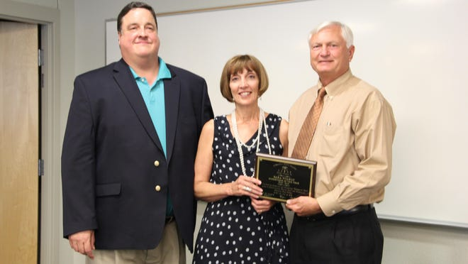 Sara Wilson, Pensacola State College Student Services director at the Milton campus, was named Supervisor of the Year. She is pictured with Tom Gilliam and PSC President Edward Meadows.