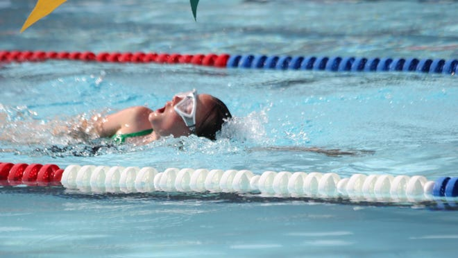 A swimmer takes a quick breathe during an event at the Heat Stroker Invitational.