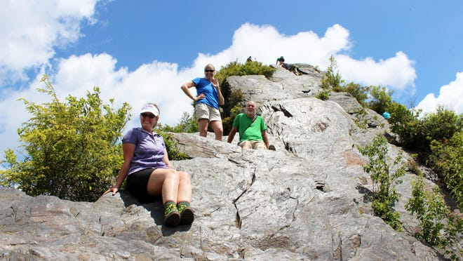 Hikers head out to the very top of the Chimney Tops Trail, which requires the use of hands and feet to climb. Because of its small capacity and extreme steepness, the Park Service does not plan to build trail out to the top of the Chimneys.