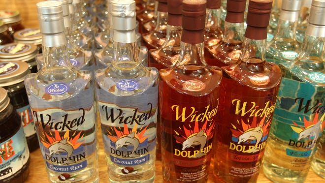 Annabelle Tometich and Anne Reed, food and dining writers at The News-Press participate in a rum tasting event at the Wicked Dolphin Distillery in Cape Coral on Wednesday.