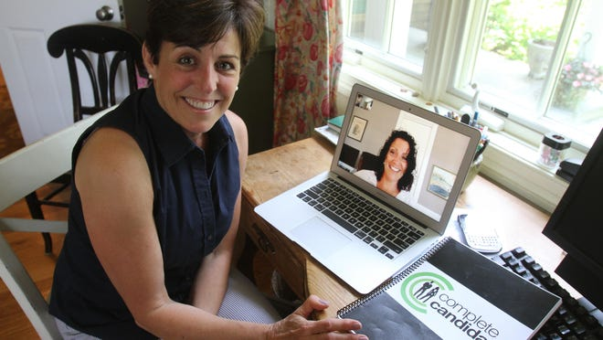 Nadine Varca Bilotta skypes with her business partner Nancy Murphy from her home office in Mamaroneck. The two women started a new business, Complete Candidate, that helps recent grads in their job search.