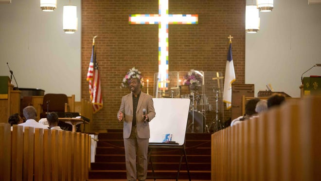 Pastor Charles Amos leads the Bible study at St. Paul U.A.M.E. Church, which is celebrating its 128th anniversary. Part of its secret to longevity is that it continues to evolve and reinvent itself in order to remain relevant in an ever changing world.