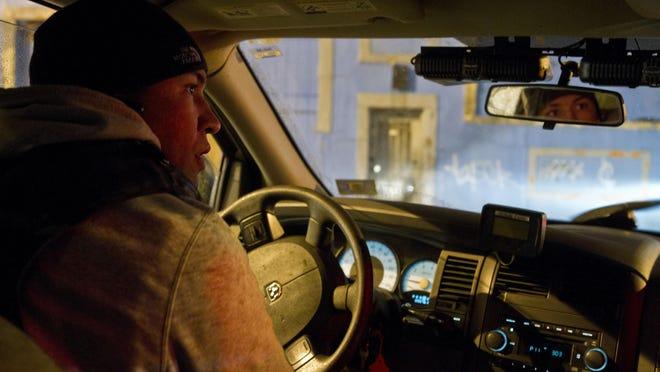 Patrolman Sean Deshader of the Asbury Park Police Department drives through the city during a routine patrol.Asbury Park, NJTuesday, December 2, 2014Doug Hood/Staff PhotographerAsbury Park Press