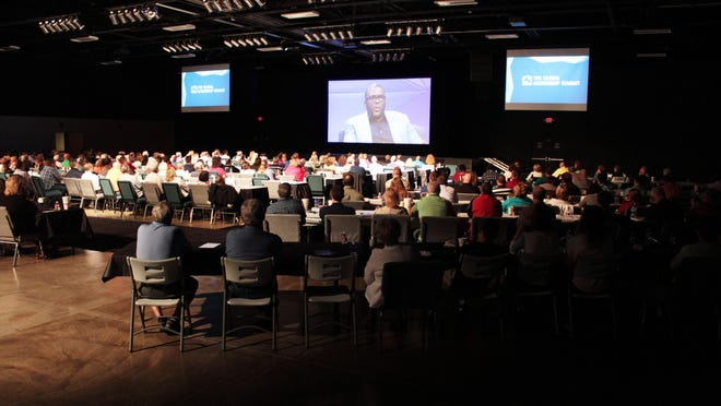 People watch the 2014 Global Leadership Summit, which is an international event broadcast live and showcasing a variety of leaders. The goal is to inspire Christ-centered leadership.