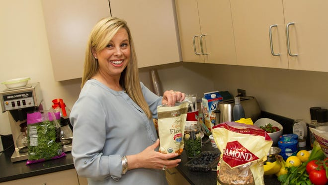 In a pantry kitchen at City Hall, Reno Mayor Hillary Schieve prepares a kale, banana, almond, flaxseed and pomegranate juice shake. The shake is a go-to meal that helps sustain the mayor during long days running the city.