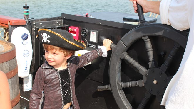 Braxton Southern, 4, tries his hand at steering the Good Fortune pirate ship.